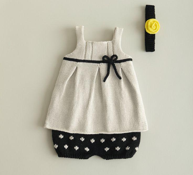 Pour les filles, cette petite robe craquante réalisée en Phil Coton 3, un fil 100% fibres naturelles. Modèle tricoté en jersey et côtes fantaisie, agrémenté d'un noeud à la taille.Modèle tricot n°12 du catalogue 85 Layette Bébé.
