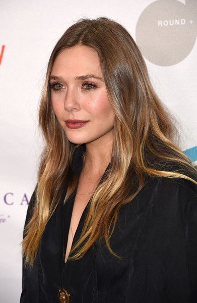 "Elizabeth Olsen Photos Photos - Actress Elizabeth Olsen attends Equality Now's third annual ""Make Equality Reality"" fundraising gala December 5, 2016 at the Montage Hotel in Beverly Hill, California.  / AFP / Robyn Beck - Equality Now's 3rd Annual 'Make Equality Reality' Gala - Arrivals"