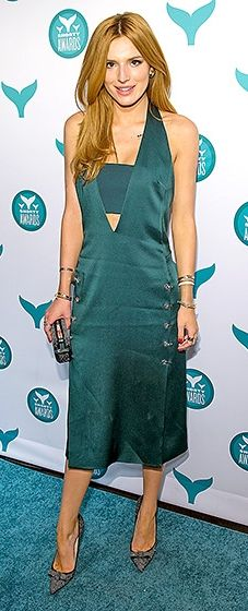 """Working it in green! The Disney actress hit the carpet in a plunging silk dress with a peekaboo bandeau top. She accessorized with a bold clutch and the Jimmy Choo """"Maya"""" pump."""