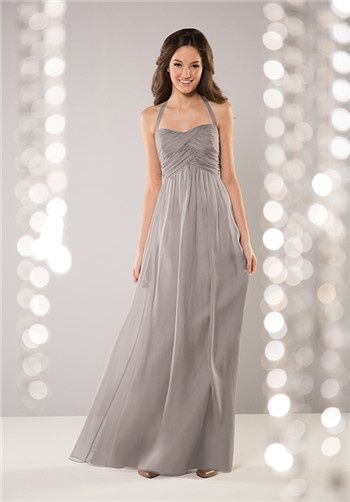A-line Madelyn Silky Chiffon gown with reverse-v waistline, gathered skirt, and ruched bodice with a halter neckline. Also available in short length.