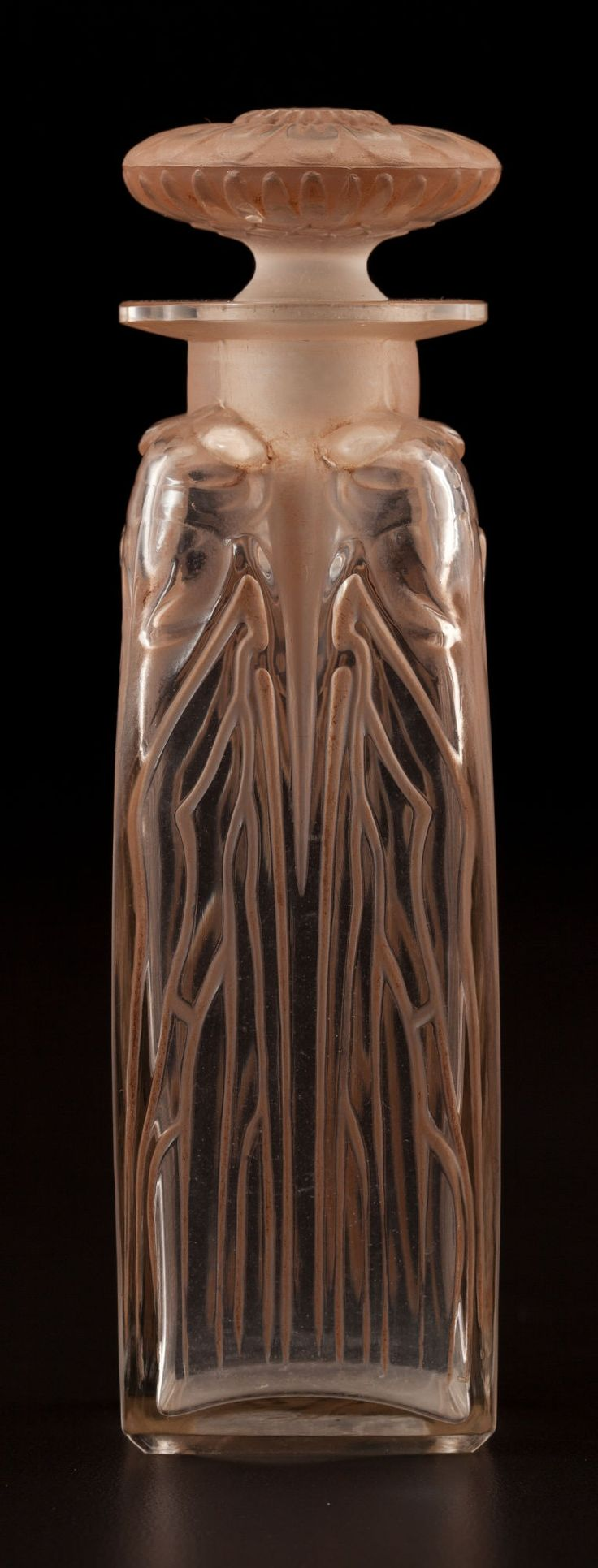 R. LALIQUE. 'QuatreCigales' perfume bottle with sepia patina, circa 1910.