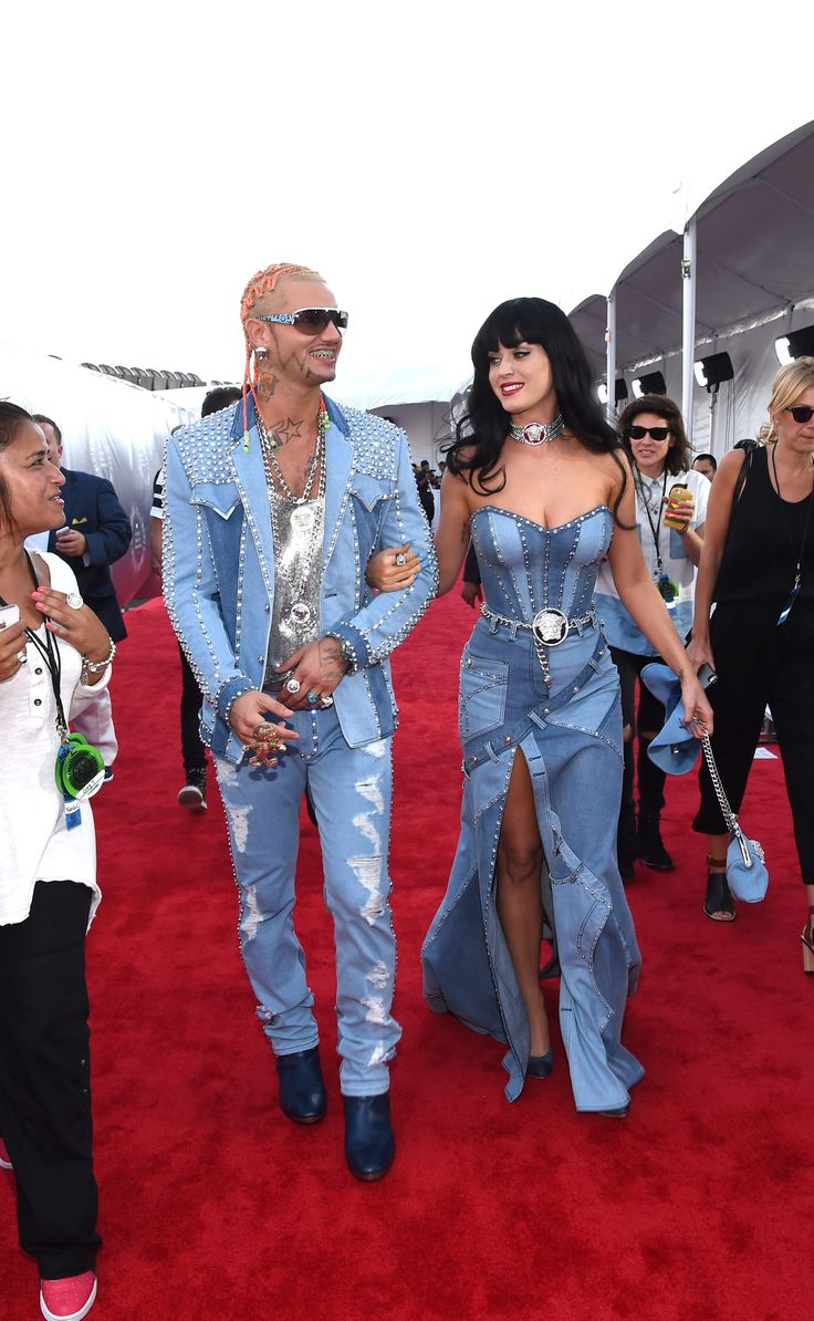 Rapper Riff Raff (L) and singer Katy Perry both wear Versace attend the 2014 MTV Video Music Awards in all denim. via @stylelist