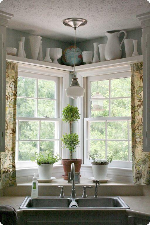 corner sink, raised counter behind sink, shelf above window, school house light (she DIY'd it!)...love it all!: