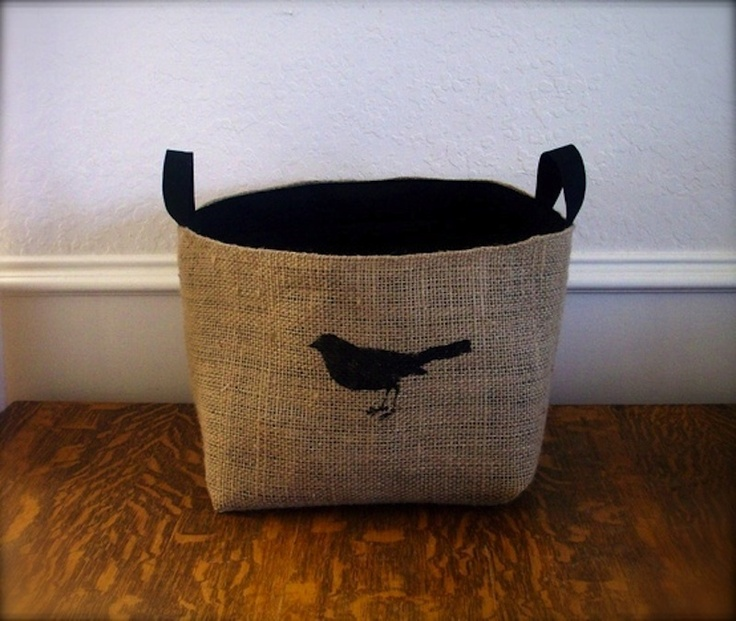 Coffee Sack Basket (XL) featuring a bird image with black canvas lining.  Urban chic, these sturdy baskets are perfect for storing your magazine collection, toys, throws or towels.  They make a fantastic gift for anyone.  Bag size as follows:  X-LARGE Approximate Measurements: height: 25cm width: 28cm length: 28cm  Made from hessian (sourced from a local coffee house in the US) & 100% black cotton canvas lining.  All seams are reinforced.  Upcycled repurposed materials  *Dry Clean ONLY*