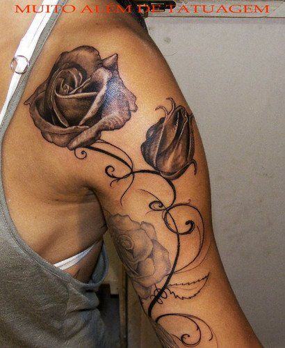 Amazing tattoo elegant black and white roses on a female hand and shoulder - Rose tattoos gallery
