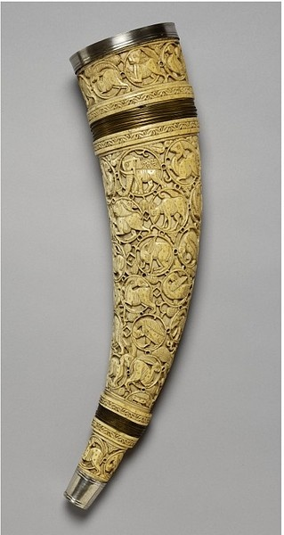 An oliphant is an ivory horn. This one is carved with a network of interconnected circles containing birds, antelopes, hares and other, more fantastic creatures. The style of decoration is derived from Islamic art, possibly textiles or ceramics produced in Cairo between the 10th and 12th centuries. Made in Amalfi or Salerno, ca. 1000-1100.