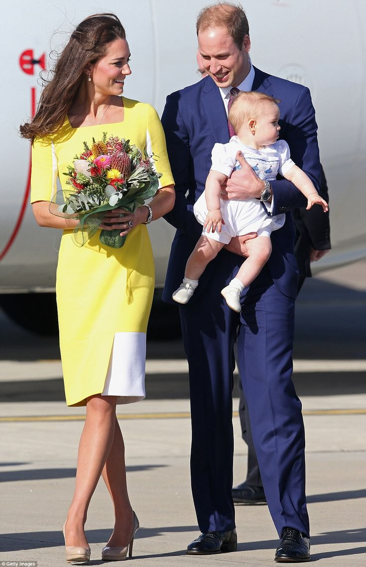 Happy: The couple looked to be in good spirits as they arrived in Sydney, with Kate apparently amused by a very curious George #katemiddleton #princegeorge