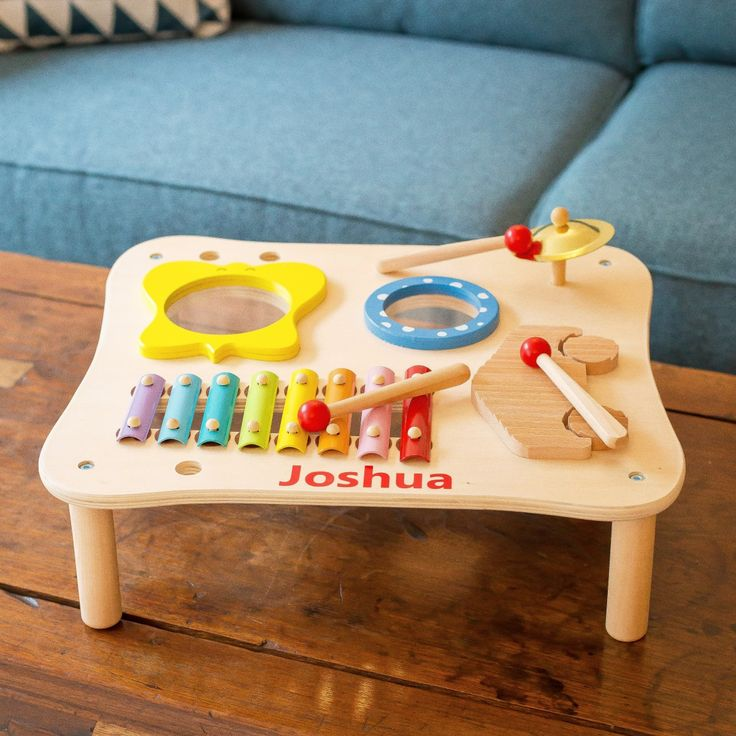 Personalised Wooden Music Maker Table  Children will be engrossed and enchanted by the musical instruments included in this set which will keep them happy, for hours.  The three instrument set are: a drum; a xylophone; miniature cymbals,and rhythm sticks.  Beautifully constructed to a high standard, this children's music set encourages hand to eye coordination as well as the early development of musical skills. Most importantly, fun is guaranteed.