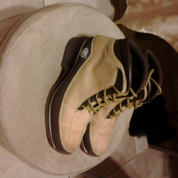 Timbaland boots very cool They are tan brown with shoelaces hi top with a very cute good for walking and hiking very rugged heels very good quality use several times good condition trading price $100 Timberland Shoes