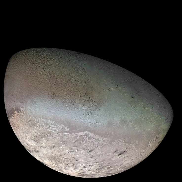 Triton, largest moon of Neptune, taken from the Voyager 2 spacecraft. It is one of only three objects in the solar system with a nitrogen-dominated atmosphere - the other two being Earth and Saturn's giant moon Titan. It also has the coldest surface known in the solar system at -391 degrees Fahrenheit. At that temp, nitrogen condenses as frost.