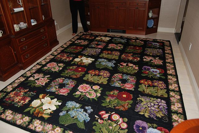 Stunning 35 panel Elizabeth Bradley needlepoint rug with Wild Rose & Forget-Me-Not border