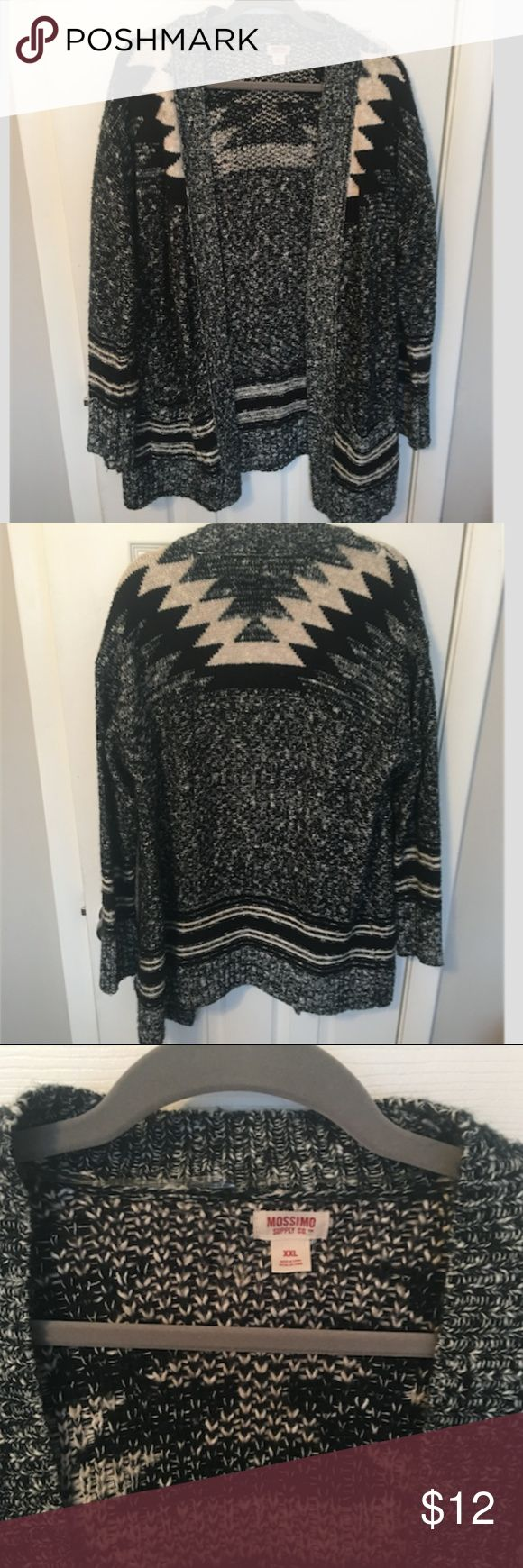 Mossimo Knit Black & White Tribal Print Cardigan A gorgeous black and white knit cardigan from Mossimo! Features a beautiful tribal-like pattern, with pockets on the front. Does not have any buttons or zips, simply hangs open in the front. In great condition. 52% Cotton 48% Acrylic. Size XXL. Mossimo Supply Co. Sweaters Cardigans