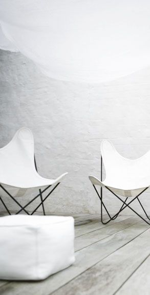 butterfly chairs, decking and white