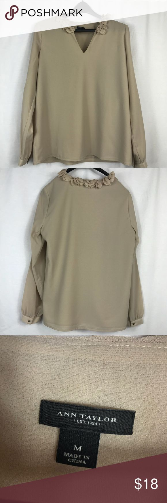 Ann Taylor Embellished Beige Long Sleeve SZ M Ann Taylor Embellished Beige Long Sleeve SZ M. Beautiful neutral long sleeve top with floral embellishments around the collar. V neck. There is a water spot and dark spot near the V-neck that will probably come out with cleaning. See pics for measurements or let me know if I can help. Offers are always welcome!! Ann Taylor Tops Blouses
