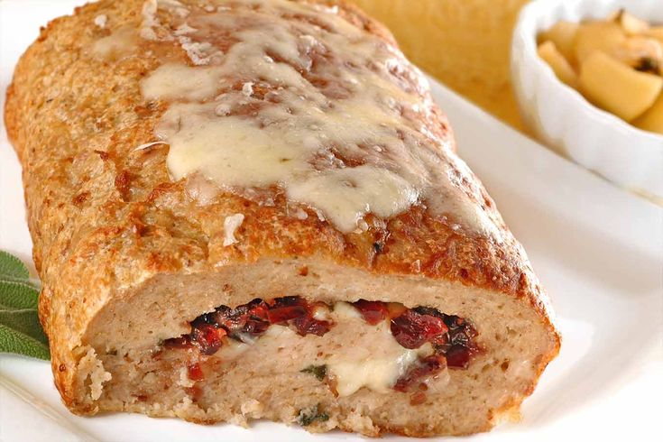 This turkey meatloaf is stuffed with a combination of dried cranberries, fresh sage and grated Jarlsberg cheese - good looking and tasty enough to serve for company.