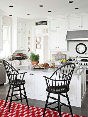 Love the windsor stools and red-patterned rug! #kitchen #color