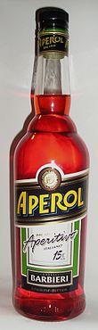 """""""Aperol ist eine Marke der Campari-Gruppe für einen italienischen Likör.[1] Wegen seines fruchtig-bitteren Geschmacks wird er meist als Aperitif oder in Cocktails verwendet. Er ist ein Destillat aus Rhabarber, Chinarinde, Gelbem Enzian, Bitterorange und aromatischen Kräutern mit orange-roter Färbung und bittersüßem Aroma. Aperol hat in Italien einen Alkoholgehalt von 11 % Vol., in Deutschland seit Anfang 2006 15 % Vol. """" Aperol – Wikipedia"""