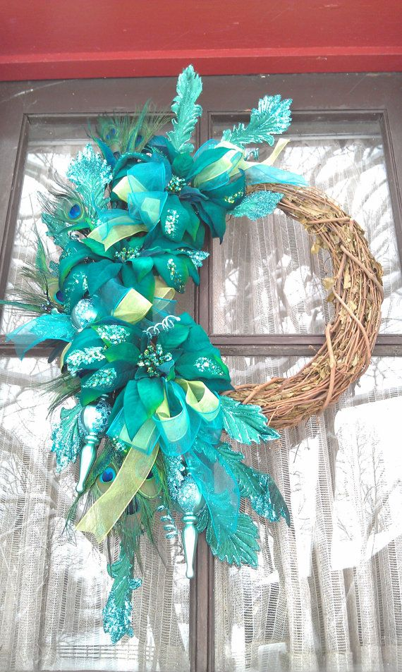 Teal, Blue, Green Christmas Wreath with Peacock Feathers and Ornaments via Etsy.
