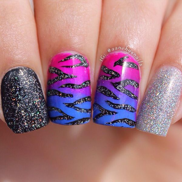 Animal print glitter nail art design on top of a gradient inspired polish in pink and blue combination.