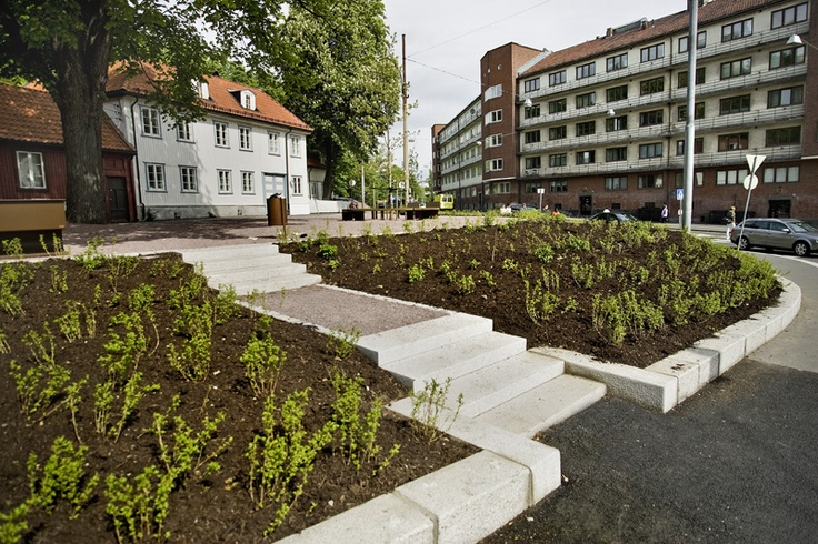 The Trekantplassen square, which was previously a dilapidated car park, has now been converted into  thriving meeting place with trees and benches as well as plants and flower on the slopes.
