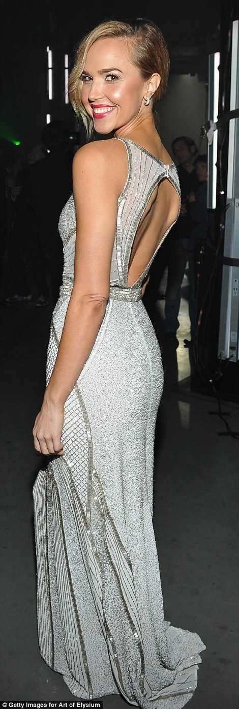 All that glitters: Former 90210 actress Arielle Kebbel showed stunning in a beaded silver dress with keyhole back