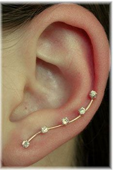 I have been looking for an ear pin for so long. Would love one of these with little cat feet.