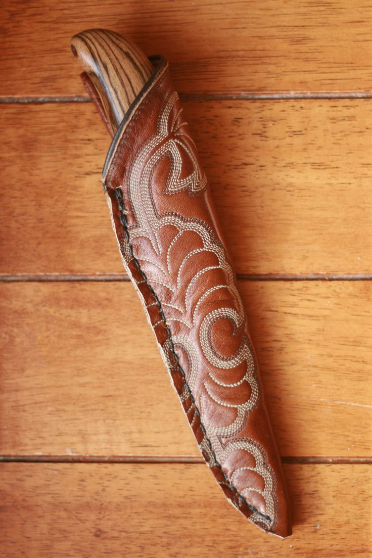 Bakote handled knife with cowboy boot sheath.