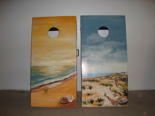 cornhole boards hand painted front daytime beach and sunset beach