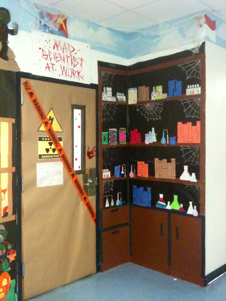 "fall festival idea. older kids help with science experiment stations for younger kids. dress up as mad scientists.Classroom door Halloween decorations. ""The Mad Scientist Lab"""