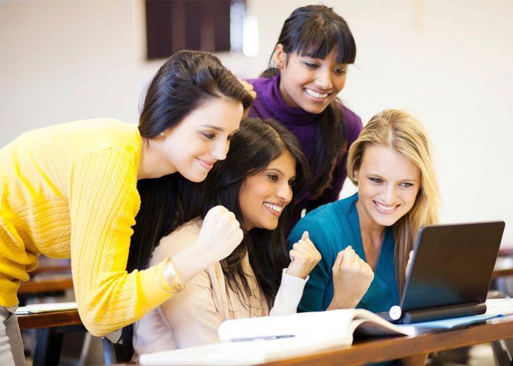 Female college students celebrating pedagogical success.