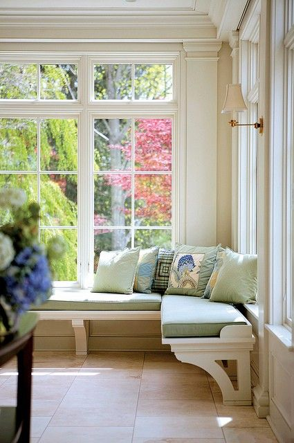 I love everything about this picture! The window trim, the sconces, the seats, ALL of it!
