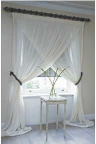 Elegant window treatment. Possibly for round window?