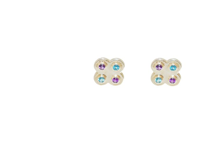 This sterling silver four leaf clover stud features dainty faceted blue topaz and amethyst gemstones.