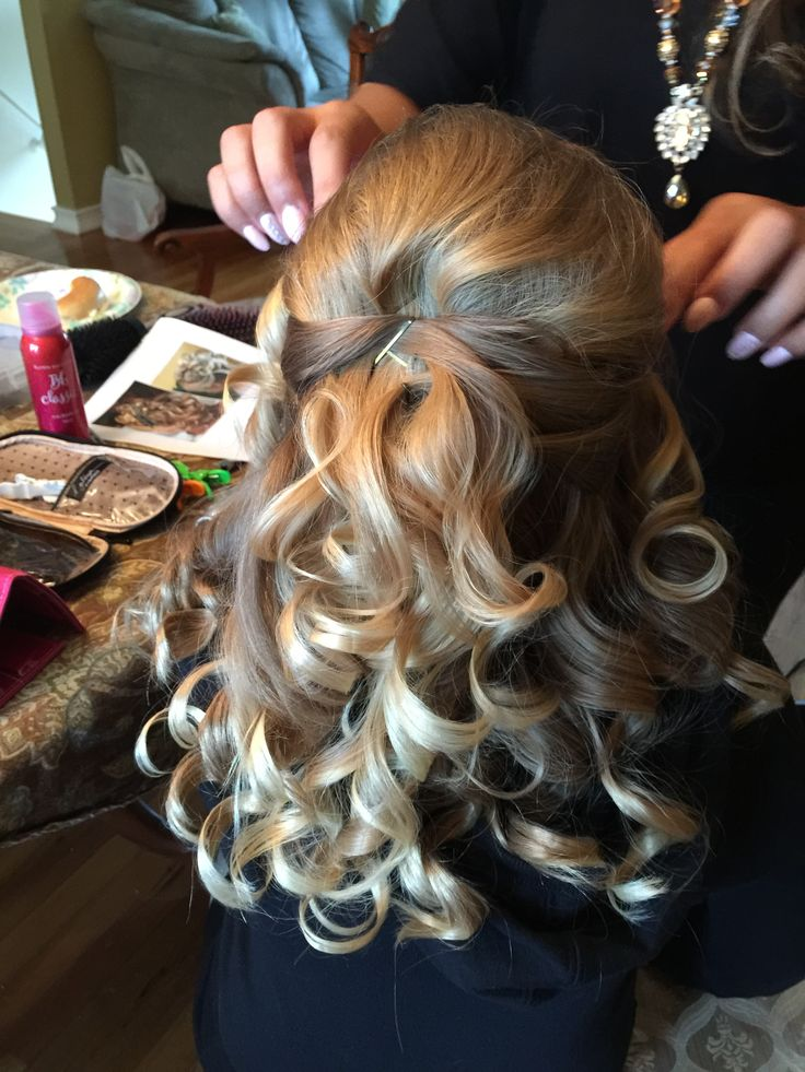 Gracie's awesome communion hair!                                                                                                                                                                                 More