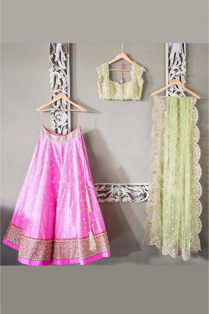 This Super Stylish Net and Banglori Silk Lehenga Choli Is Exclusively Crafted With Embroidery,Lace Work,Stone Work. The Pink and Green Colour Lehenga Choli Comes With Matching Dupatta and Unstitched C...