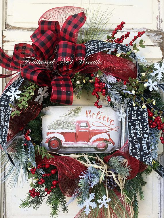 This Christmas Wreath is made on a Pine Base. I have Layered it with An Assortment of Snowy and Green Pine, Red Berries, Artificial Boxwood with Cream Berries, Wired Snowflakes, Red and Black Checked Ribbon, a Wired Chalkboard Style Ribbon, and Red Deco Mesh. I Finished out the Wreath with a Sign that has an Old Red Truck with Christmas Tree. This Wreath Measures 24 x 24... Measuring Tip to Tip. Very Sweet and Cozy Wreath <3