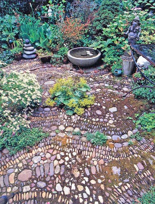 Stone mosaic garden floor...idea for our sun trap?
