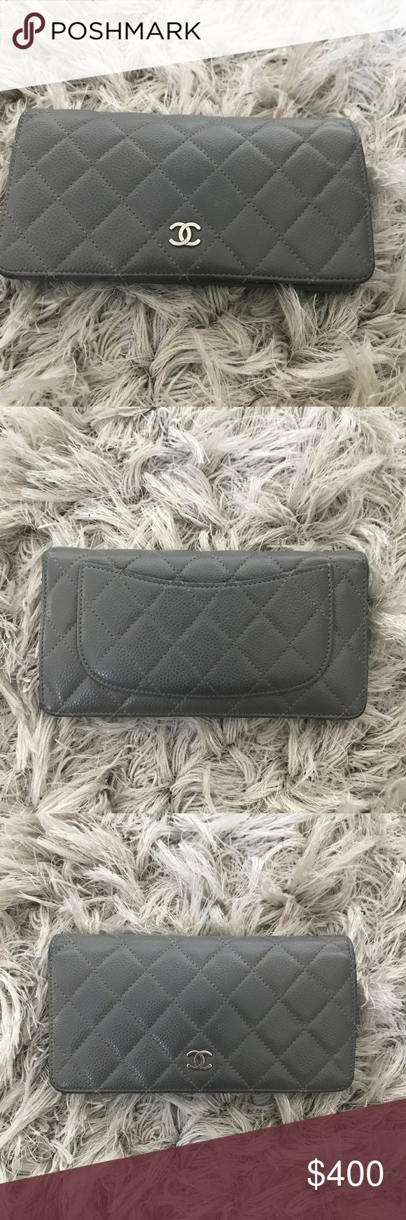 Authentic Chanel Grey Wallet 100% authentic Chanel wallet. Color grey. Made in France. Purchased at Saks Fifth Avenue. Has normal wear and tear, which is reflected in price. I do not have original box or authenticity card. CHANEL Bags Wallets