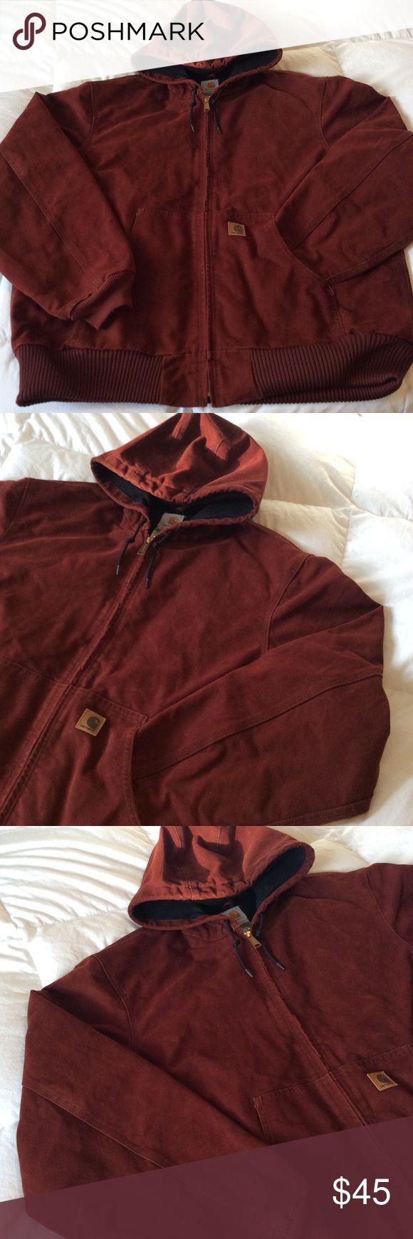 Heavy Duty Hooded Carhartt Coat xL Men's XL thick heavy duty carhartt coat. Front pockets and a pocket inside. The zipper works but is a bit stubborn. Brick red burnt orange color. Carhartt Jackets & Coats