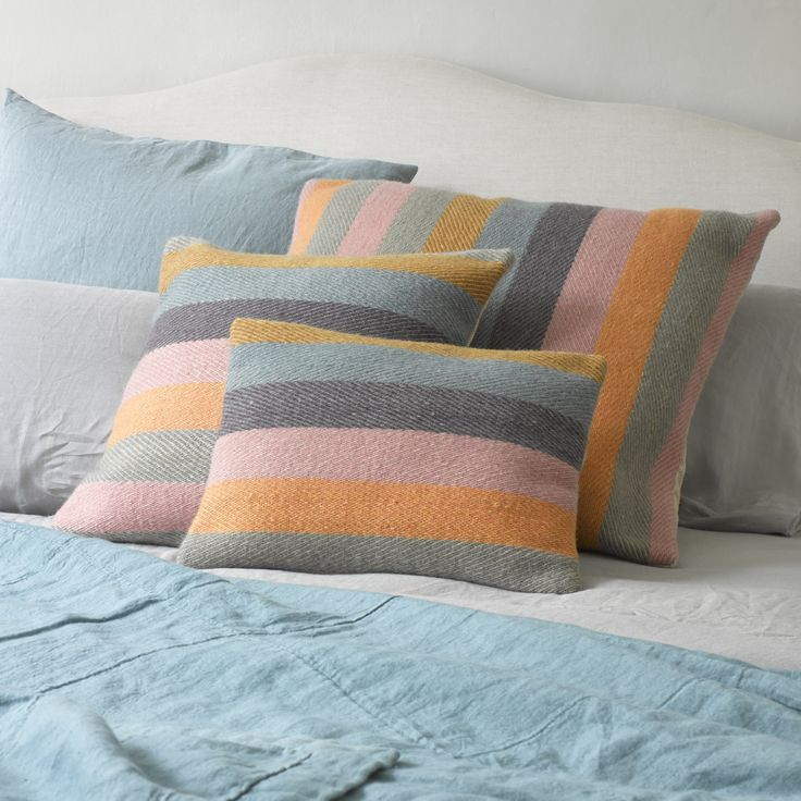 HA'PENNY CUSHION These rainbow rascals are hand-woven in Varanasi from 100% wool. The reverse stitching detail is enough to make our mouths water...YUM.