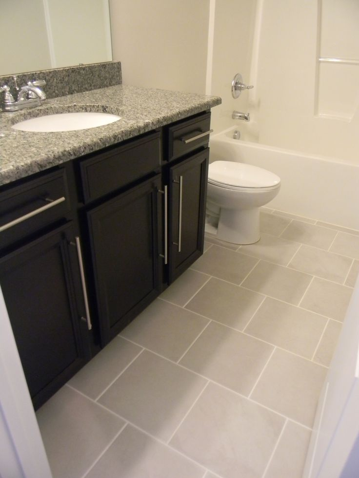 timberlake tahoe maple espresso cabinets new caledonia granite ao bevalo dove ceramic tile bathroom