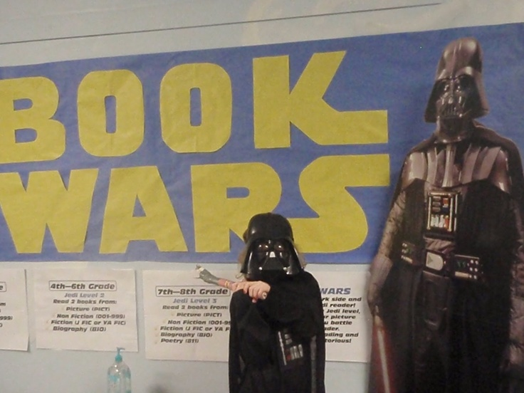 Mrs. Decker in the library, one of the library reading incentive programs for my students. They earned Jedi levels of reading and the opportunity to battle Darth Vader!