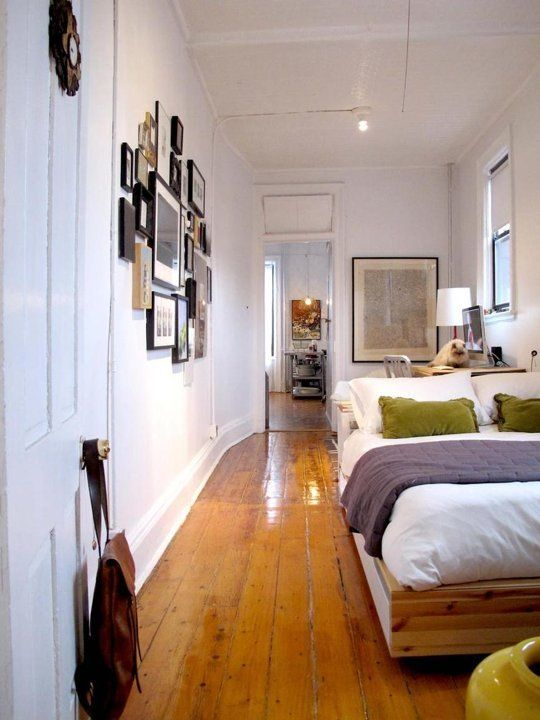 Break up long walls with clusters of artwork or decor. Avoid series of frames hung side by side that are all the same. Ideas to Steal from The Narrowest of Bedrooms