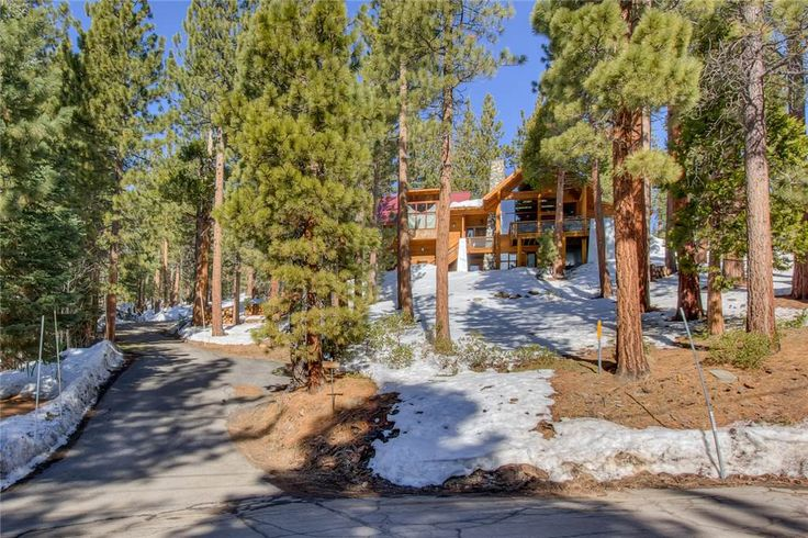 This custom home was built as an artist's retreat in the Tahoe Lodge style. Well above Kings Beach, only a mile and a half from the lake and Safeway, the house is surrounded by National Forest on three sides. There are views of the lake from almost every room and the hot tub. You can hike, mountain bike, cross-country ski and sled right out the back door. Set well off the street in natural landscape, there is plenty of privacy and off-street overflow parking.