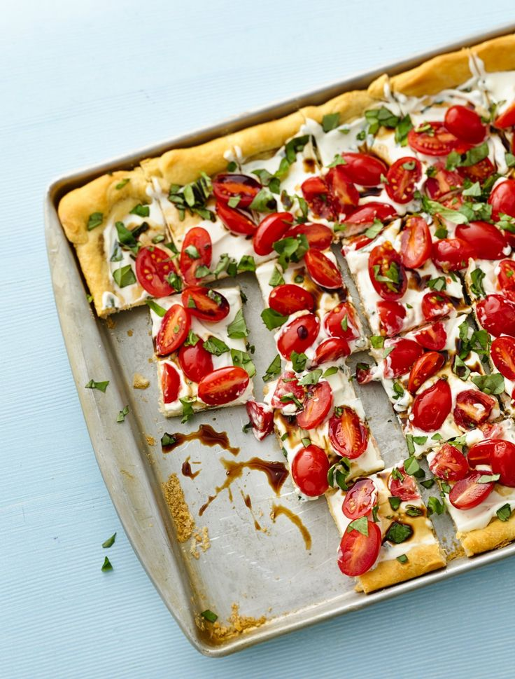 Party food made easy! Make the crust the day before, and top with cream cheese mixture. Cover tightly, and refrigerate. Just before serving, top with tomatoes, basil and vinegar.