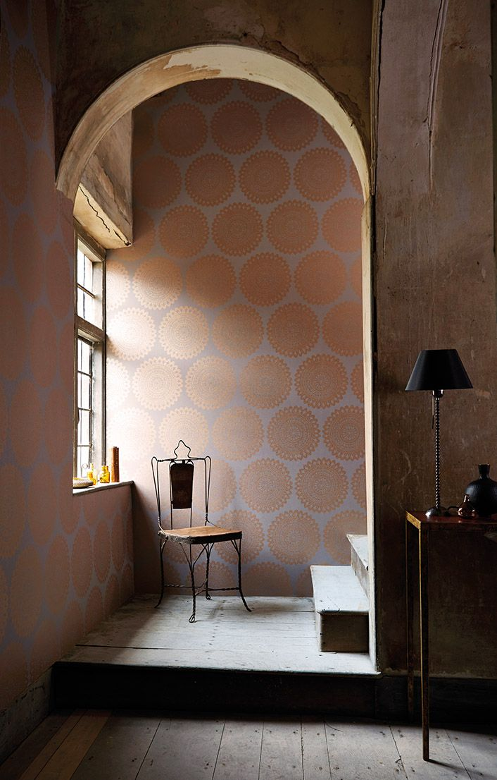 A statement hallway featuring Harlequin's Medina wallpaper in copper and grey.