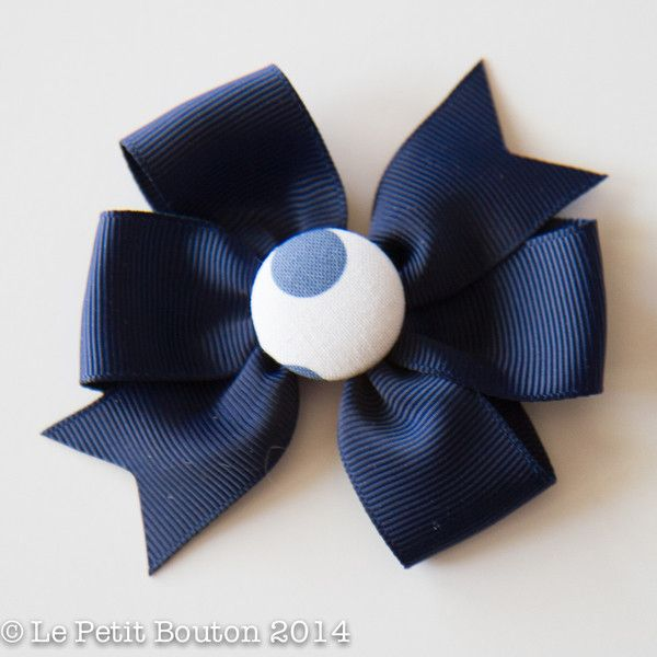 Large Navy ribbon bow on large alligator clip featuring our gorgeous spotted covered button. Button pattern may vary.