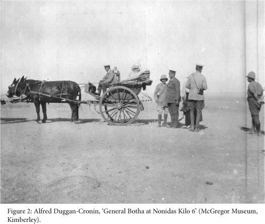 The photograph entitled 'General Botha at Nonidas, Kilo 6' depicts a group of military men standing next to a gig, a light open coach. The portly figure at the group's centre is General Louis Botha, the then Prime Minister of the Union and Commander-in-Chief of the South African armed forces. Botha had arrived at Swakopmund in February 1915 and personally coordinated the military campaign. Kronos - Arteries of empire: on the geographical imagination of South Africa's railway war, 1914/1915