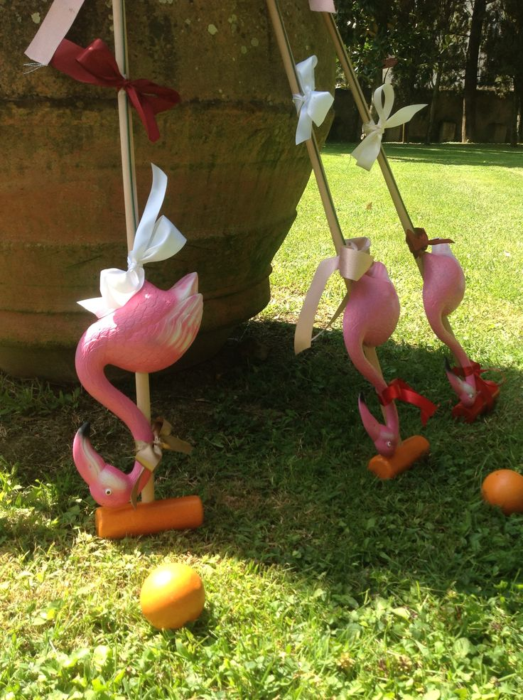 alice in wonderland theme wedding. lawn flamingos attached to a croquet club.
