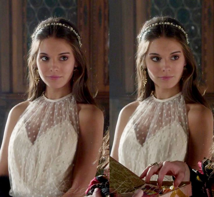 In 1x14, Kenna's white dress with white sheer dotted overlay was a vintage piece.